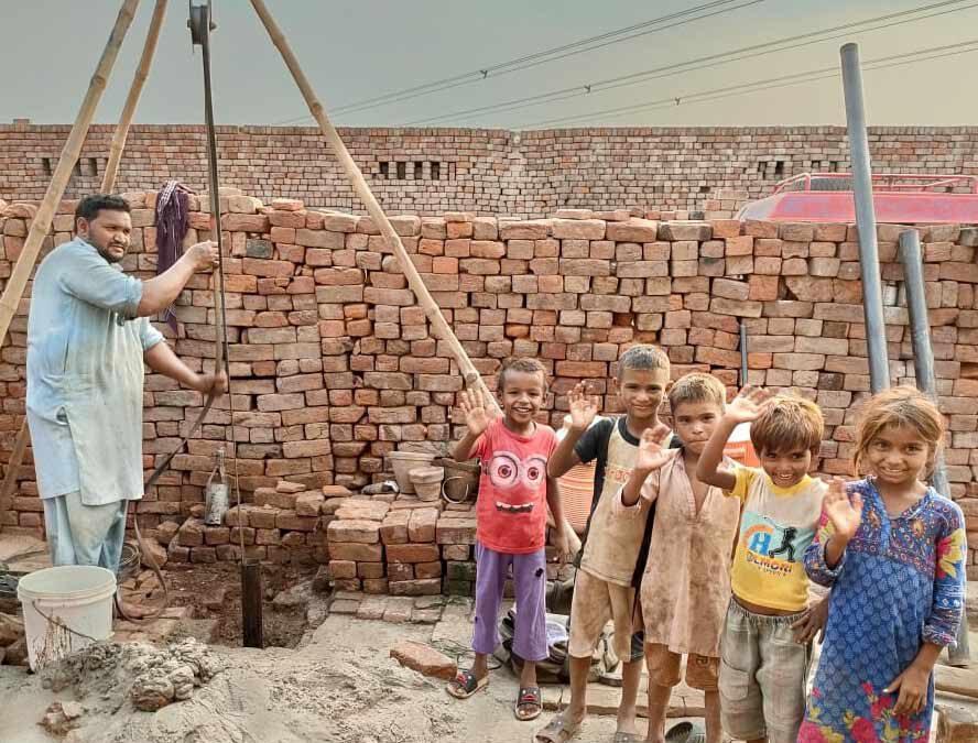 Installation of a waterpump in a brick making factory in Pakistan